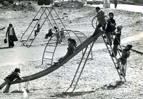 There was a line for the slide at a playground on Mass Ave. in 1977.